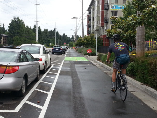 This bicycle lane is protected by parked vehicles